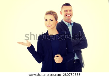 Businesspeople smiling and welcoming to their corporation