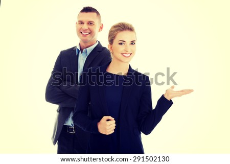 Businesspeople smiling and welcoming to their corporation - stock photo