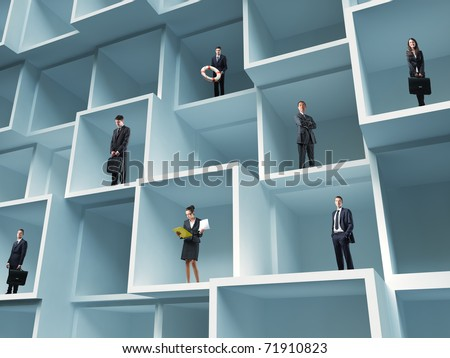 businesspeople standing in 3d boxes background - stock photo