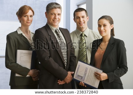 Businesspeople Standing in Office - stock photo