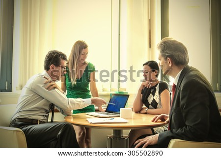 Businesspeople taking decisions - stock photo