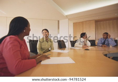 Businesspeople talking at meeting - stock photo