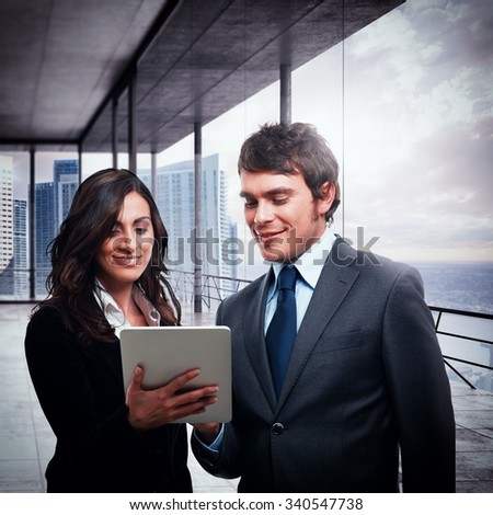 Businesspeople together analyze project on the tablet - stock photo