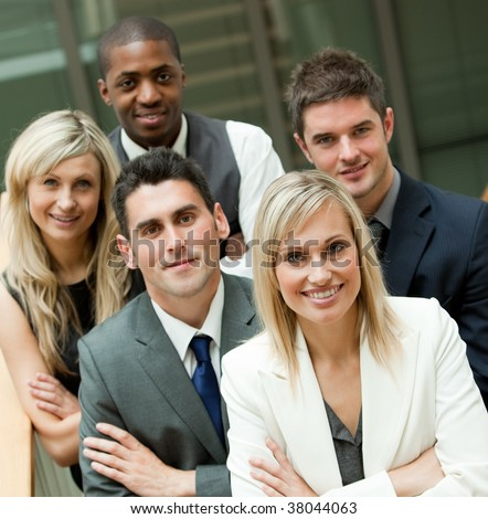 Businesspeople with a blon woman in the middle in an office - stock photo