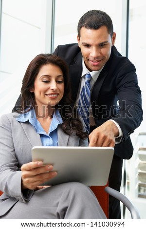Businesspeople With Digital Tablet During Informal Meeting - stock photo