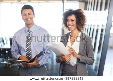 Businesspeople with document and organizer in office