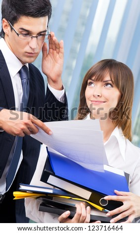 Businesspeople with documents at office