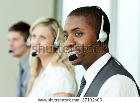 Businesspeople with headsets at work
