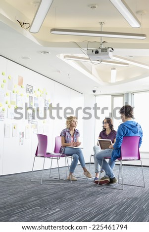 Businesspeople working at creative office space - stock photo