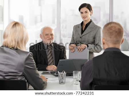 Businesspeople working at formal meeting together.?
