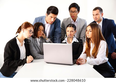 Businesspeople working on the laptop together - stock photo