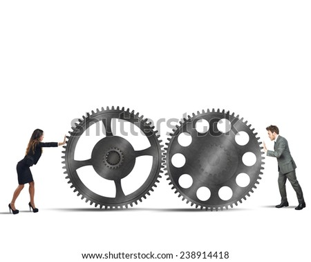 Businesspeople working together for perfect interlocking gears - stock photo