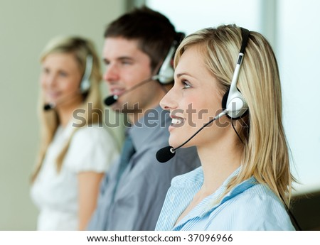 Businesspeople working with headsets in an office - stock photo