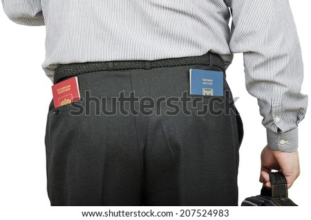 Businessperson has Russian and Israeli passports in rear pockets his black trousers. View from the back on a white background