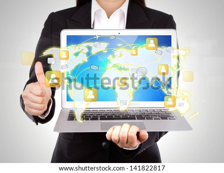 Businessperson holding an open laptop show social network with thumb up isolated on white background