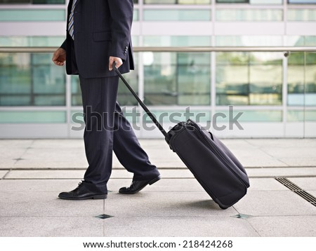 businessperson traveling with luggage. - stock photo