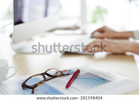 Businessperson working on computer - stock photo