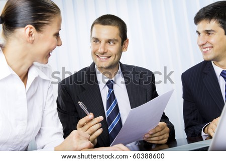 Businessteam or client and businessman, giving pen for signing document - stock photo
