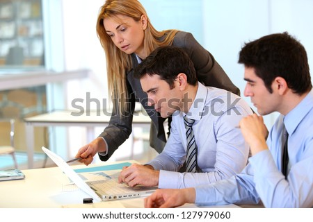 Businessteam working together on project - stock photo