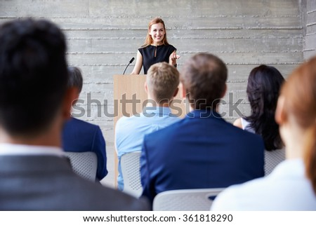 Businesswoman Addressing Delegates At Conference - stock photo