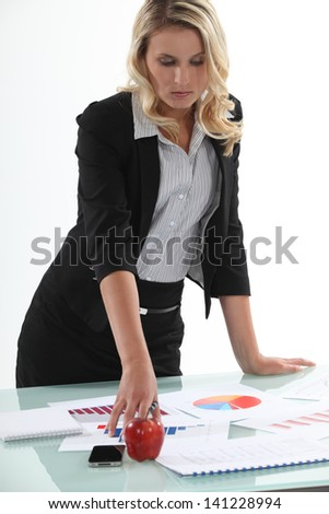 businesswoman analyzing statistics - stock photo