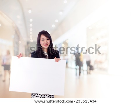 businesswoman and banner in shopping mall  - stock photo