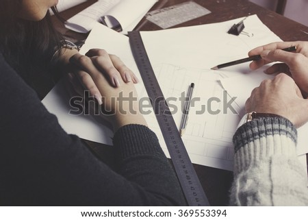 businesswoman and businessman drawing on table.