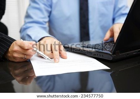businesswoman and businessman  on meeting in office  analyzing document - stock photo
