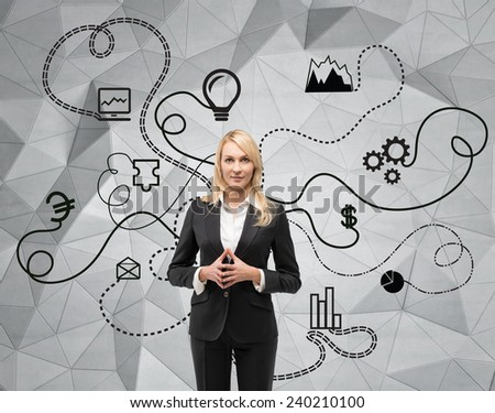 businesswoman and drawing  business scheme on wall - stock photo