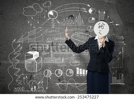 Businesswoman and graphs at background hiding her face behind mask