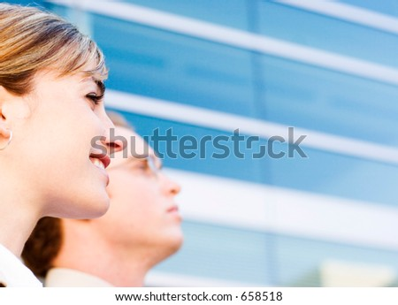 businesswoman and man look off into the difference - stock photo