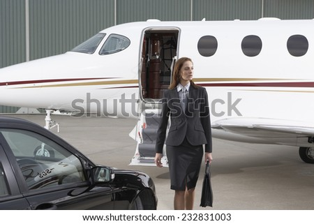 Businesswoman and Private Jet