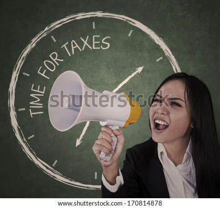 Businesswoman announcing time for taxes using megaphone