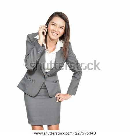 Businesswoman Asian gesture attractive standing enjoy talking on mobile phone, on white background - stock photo