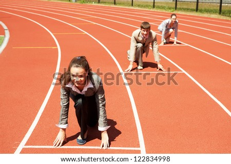 Businesswoman at athletic stadium and race track - stock photo