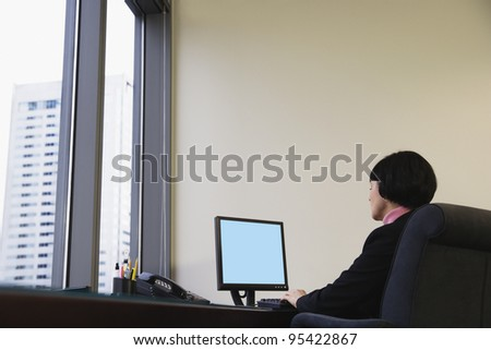 Businesswoman at desk using computer