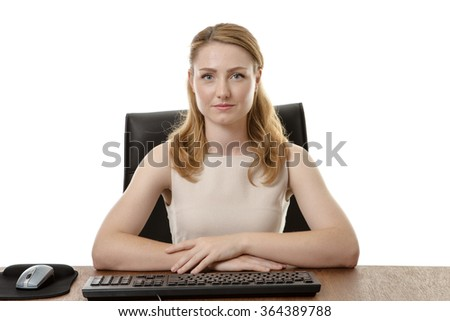 businesswoman at her desk looking at you