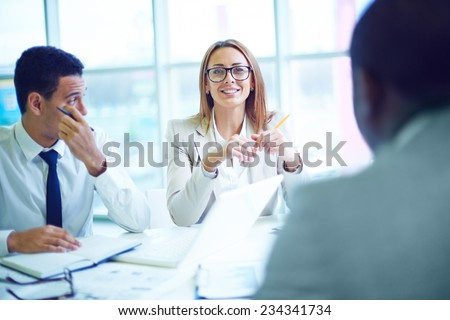 Businesswoman at meeting with men - stock photo
