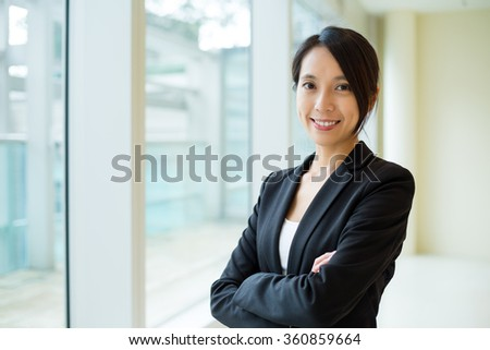 Businesswoman at office - stock photo