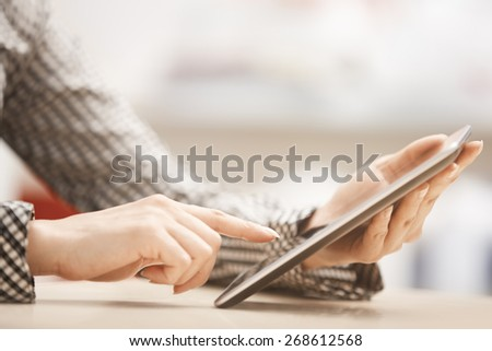 Businesswoman at office working with digital tablet