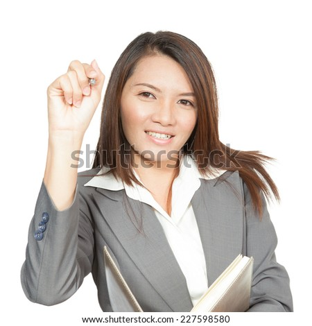 Businesswoman attractive young pretty in office standing enjoy using a pen writing diary note book smiling positive  on white background - stock photo