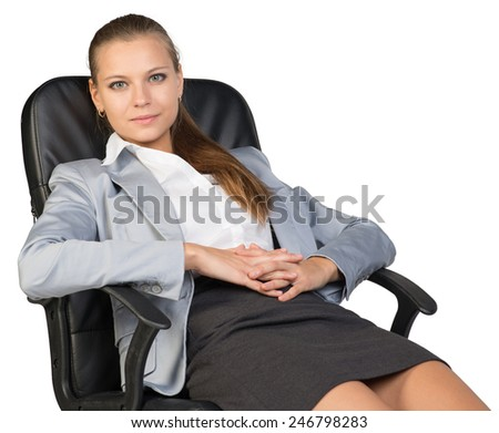 Businesswoman back in office chair, looking at camera cheerfully, with her hands clasped over her stomach. Isolated over white background
