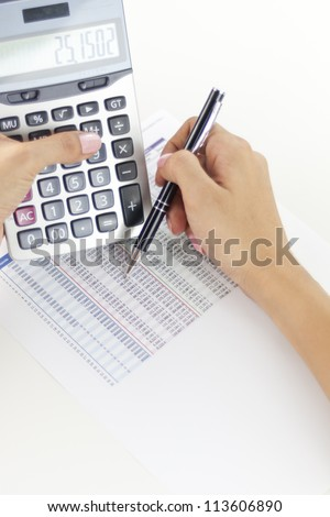 Businesswoman balancing the accounts