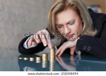 Businesswoman build euro columns, business concept, growth, extra profit - stock photo