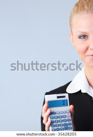 Businesswoman calculating tax returns - stock photo