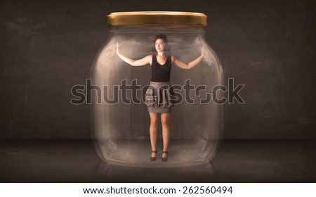 Businesswoman captured in a glass jar concept concept on background - stock photo