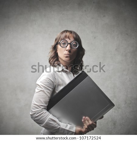 Businesswoman carrying a laptop