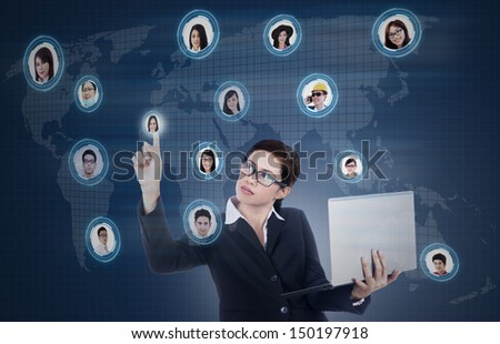 Businesswoman carrying laptop with social networking map - stock photo