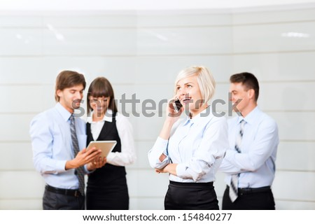 businesswoman cell phone call, at office conference hall, over businesspeople background, business woman happy smile, people at meeting comunicating working with tablet