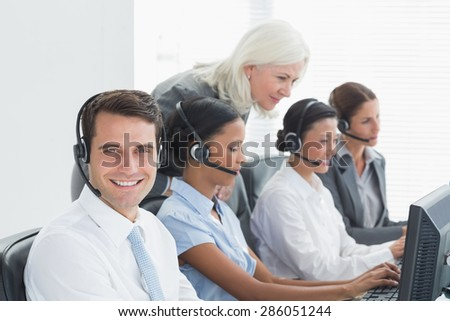 Businesswoman checking her colleagues works in office - stock photo